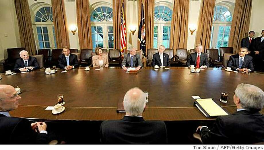 CAPTION ADDITION - NAMESUS President George W. Bush (C) makes remarks on the economic crisis during a meeting with bipartisan and bicameral members of congress including the Presidential candidates Republican John McCain (L) and Barack Obama (R) in the Cabinet Room on September 25, 2008 at the White House in Washington, DC. Left to right are McCain, House Minority Leader John Boehner, House Speaker Nancy Pelosi, Bush, Senate Majority Leader Harry Reid, Senate Minority Leader Mitch McConnell and Obama.    AFP PHOTO / TIM SLOAN (Photo credit should read TIM SLOAN/AFP/Getty Images) Photo: Tim Sloan, AFP/Getty Images