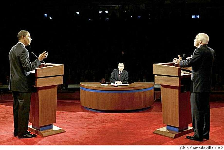 Democratic presidential candidate, Sen. Barack Obama, D-Ill. left, and Republican presidential candidate, Sen. John McCain, R-Ariz., address a question during the presidential debate Friday, Sept. 26, 2008 at the University of Mississippi in Oxford, Miss. Moderator Jim Lehrer of PBS is at center. Photo: Chip Somodevilla, AP