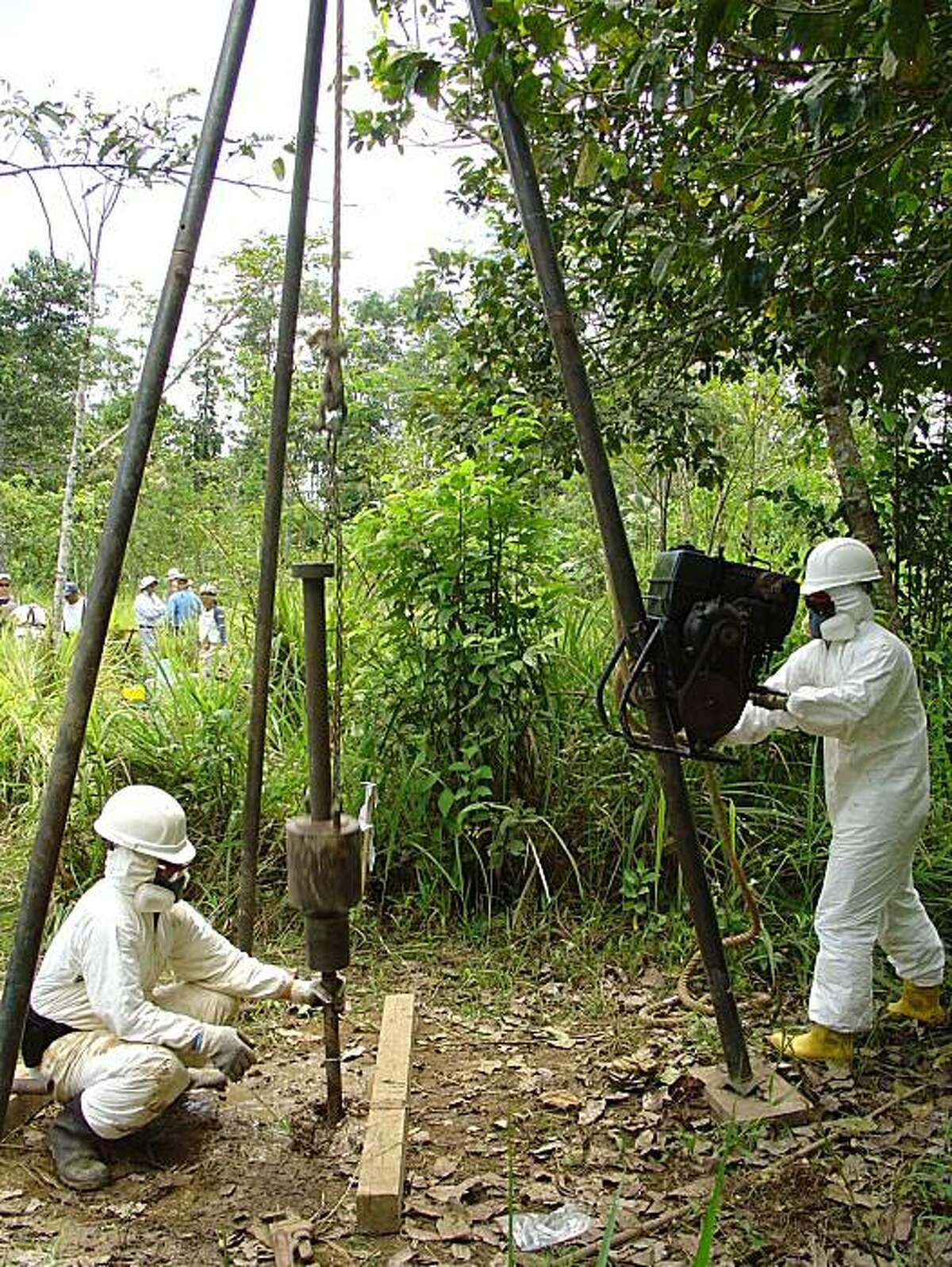 Workers take soil samples at a former oil drilling site in the Ecuadoran Amazon, looking for contamination as part of a lawsuit against Chevron Corp.