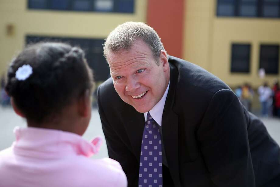 The Oakland School District's new superintendent,  Tony Smith, chats with 1st grader Chanyah Gomer, 7, on the playground during recess.    Surviving 15-years, in spite of prop-13 and the current recession, the 19 day summer school arts program, at Oakland's Glenview Elementary School in Glenview Elementary School in Oakland, Calif. thrives on Thursday, July 9, 2009. Photo: Kat Wade, Special To The Chronicle
