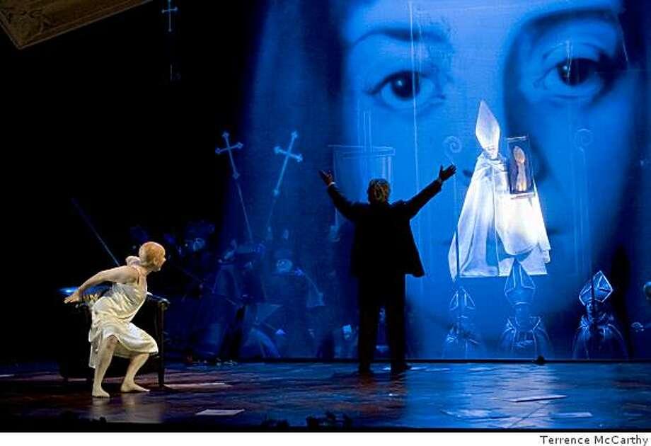 "Scene from San Francisco Opera ""Die Tote Stadt."" Pictured: ""Emily Magee (Marietta), Torsten Kerl (Paul), Lucas Meachem (Fritz)"" Photo: Terrence McCarthy"