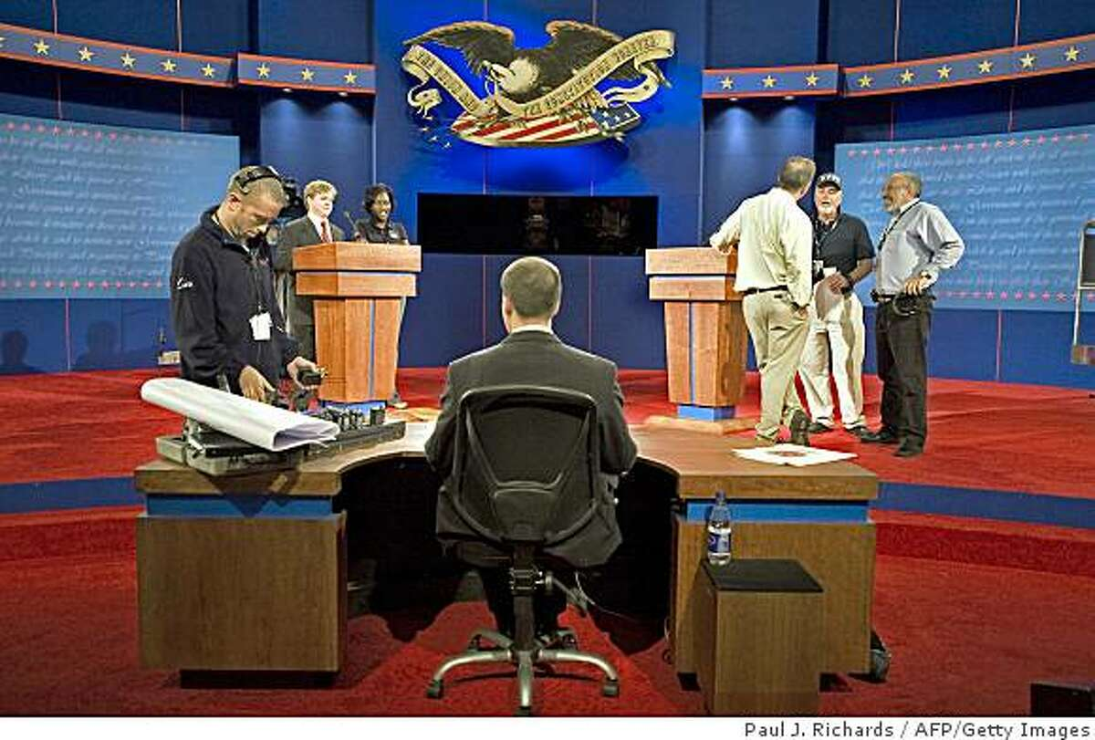 Stage and production crews make last minute adjustments to the set of the first presidential debate September 25, 2008 at the Ford Center in Oxford, Mississippi. The first debate is scheduled be in Oxford, MS, on September 26, then a Vice-Presidential debate in St. Louis Oct 2, followed by President debates in Nashville Oct 7, and Hempstead, NY Oct 15. The September 26 debate is in question as Arizona Sen. John McCain announced he would temporarily suspend campaigning to return to Washington to help with the agreement on a proposed $700 billion-dollar bailout of financial institutions before Congress. AFP PHOTO/Paul J. Richards (Photo credit should read PAUL J. RICHARDS/AFP/Getty Images)