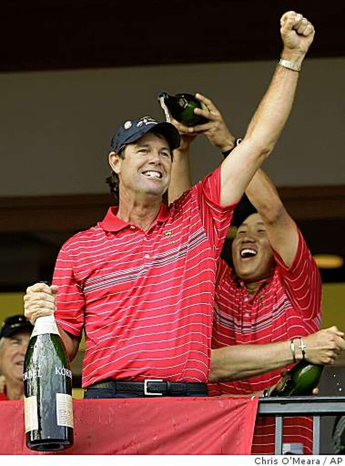 United States team captain Paul Azinger and Anthony Kim, right, celebrate after winning the Ryder Cup golf tournament at the Valhalla Golf Club, in Louisville, Ky., Sunday, Sept. 21, 2008.  (AP Photo/Chris O'Meara) Photo: Chris O'Meara, AP