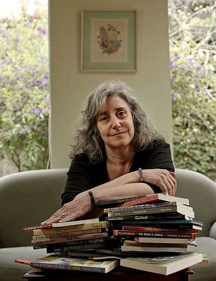 Jennifer Joseph, with various works her company has published, throughout the years,  Joseph at her San Francisco, Calif. home on Friday Apr. 2, 2010. Jennifer Joseph is the founder of Manic D Press, an independent publishing house which is celebrating it's 26th year as a San Francisco outlet for alternative voices. Photo: Michael Macor, The Chronicle