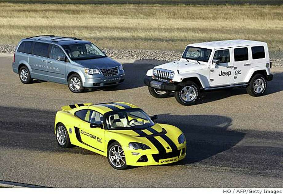 This Chrysler handout photo received on September 23, 2008 shows three advanced electric-drive vehicle prototypes, the Chrysler EV, Dodge EV and Jeep EV in Aurburn Hills, Michigan. Chrysler this week joined the ranks of automakers promising to bring electric cars to the market in 2010. The US automaker on September 23, 2008 unveiled three plug-in prototypes: an all-electric sports car and an electric minivan and a Jeep outfitted with range-extending gasoline engines. Just one will be produced for North American drivers in 2010 and later introduced to European markets, Chrysler said. Just one will be produced for North American drivers in 2010 and later introduced to European markets, Chrysler said. AFP PHOTO/CHRYSLER/HANDOUT/RESTRICTED TO EDITORIAL USE =GETTY OUT= (Photo credit should read HO/AFP/Getty Images) Photo: HO, AFP/Getty Images