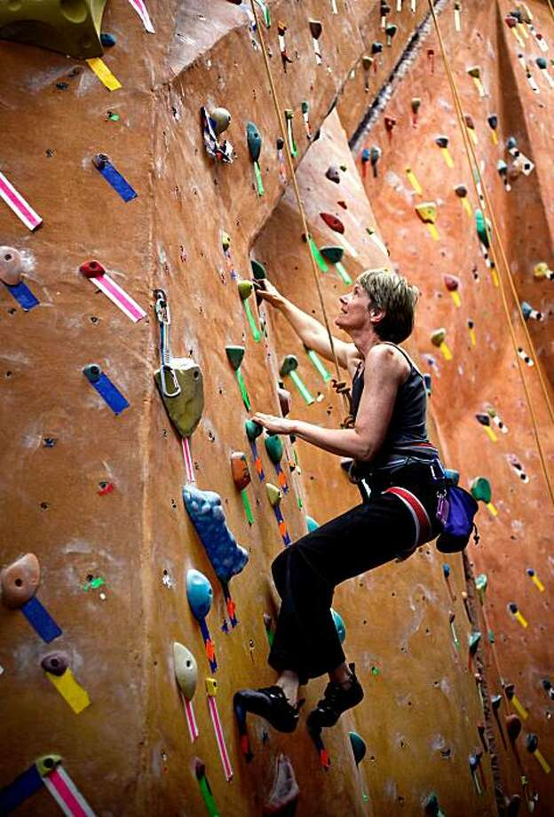 """Cynthia Eastman, on Thursday Mar. 11, 2010, whose Healthy Obsession is spending her evenings on the climbing wall at the """"Great Western Power Company"""" fitness center in Oakland, Calif. Photo: Michael Macor, The Chronicle"""