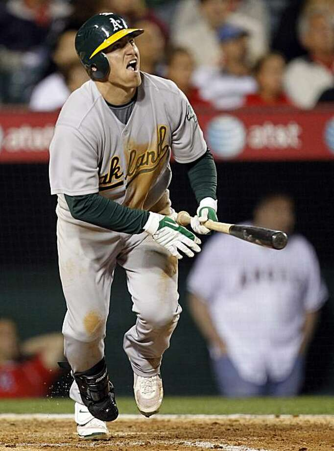 Oakland Athletics' Cliff Pennington watches his three-run home run against the the Los Angeles Angels during the seventh inning of a baseball game in Anaheim, Calif., Friday, April 9, 2010. Photo: Chris Carlson, AP