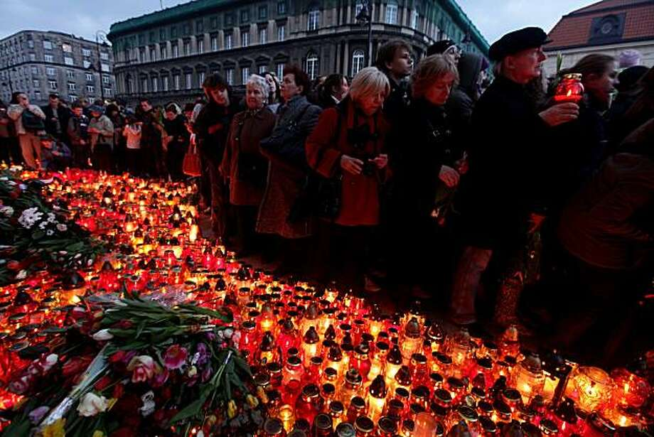 Mourners wait to lay candles and flowers outside the Presidential Palace in memory of late Polish President Lech Kaczynski on Saturday in Warsaw, Poland. Kaczynski, his wife, Maria, and leading members of the Polish military and government were killed when the presidential plane they were traveling in crashed while attempting to land at Smolensk, Russia. The delegation was on its way to attend memorial services for the thousands of Polish military officers murdered by the Soviets during World War II at Katyn. Photo: Sean Gallup, Getty Images