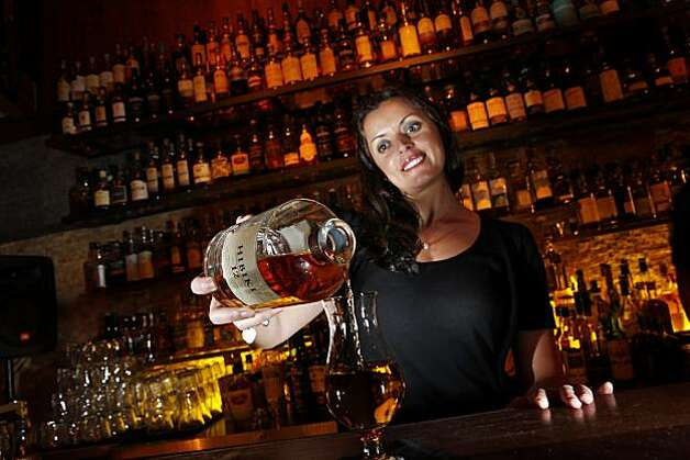 Romina Kluss pours a glass of Hibiki 12 at Nihon Whisky Lounge in San Francisco, Calif., on Tuesday, March 31, 2010. For a Food & Wine piece on Asian whiskies. The story details the rise of these whiskies, especially Japanese whiskey. Nihon specializes in these. Photo: Carlos Avila Gonzalez, The Chronicle