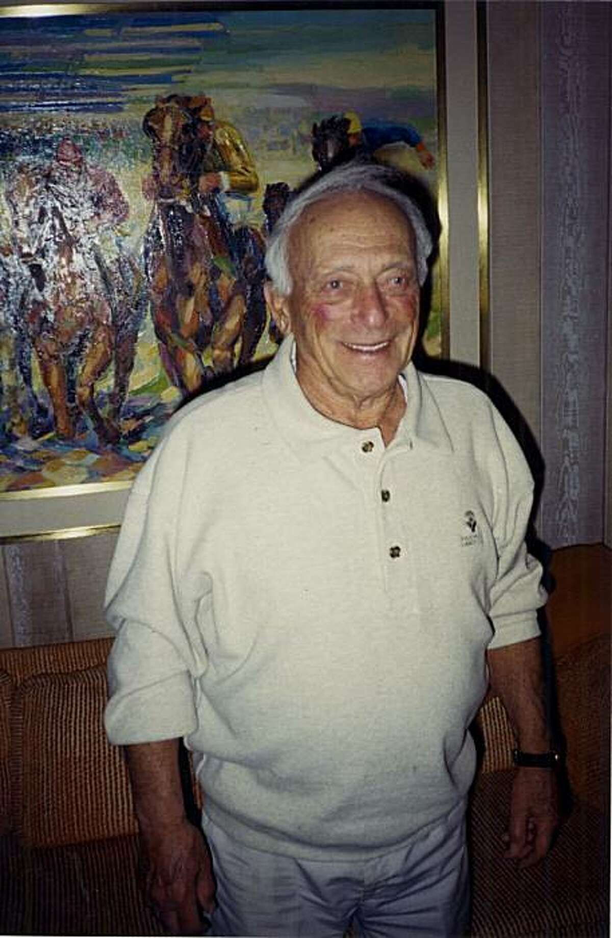 Al Ross, Doggie Diner founder, is seen in this undated photograph in his house at Canyon Country Club, beside one of his biggest passions: horse racing.