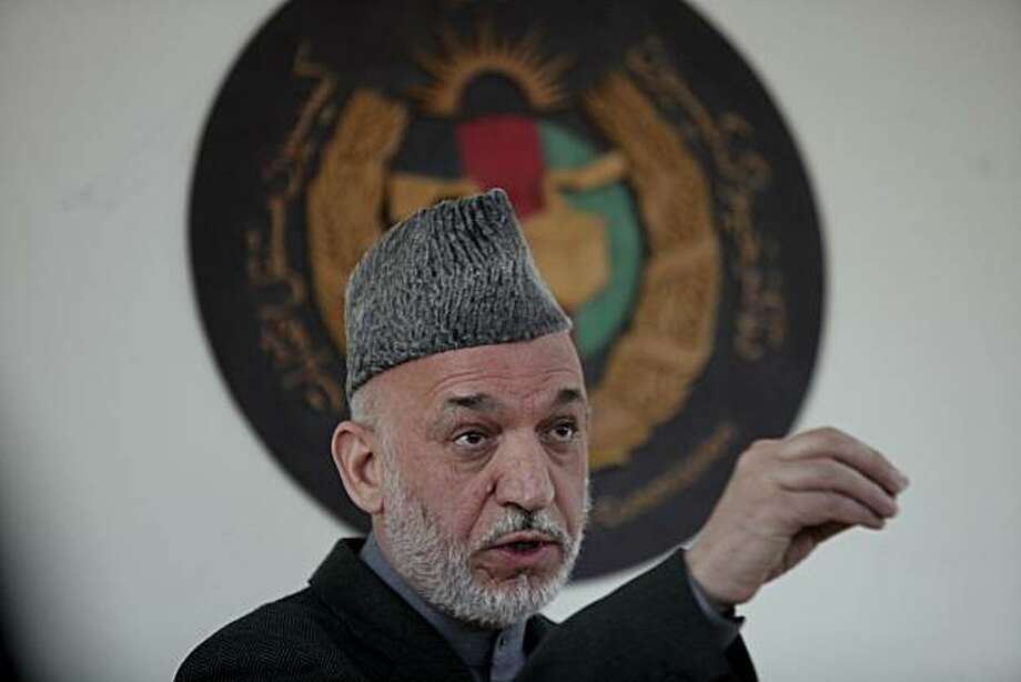 "Afghan President Hamid Karzai delivers a speech at the Election Commission office in Kabul, Afghanistan, Thursday, April 1, 2010. Karzai told election workers there had been ""vast fraud"" in the Aug. 20 ballot but that it was not committed by Afghans. Photo: Rafiq Maqbool, AP"