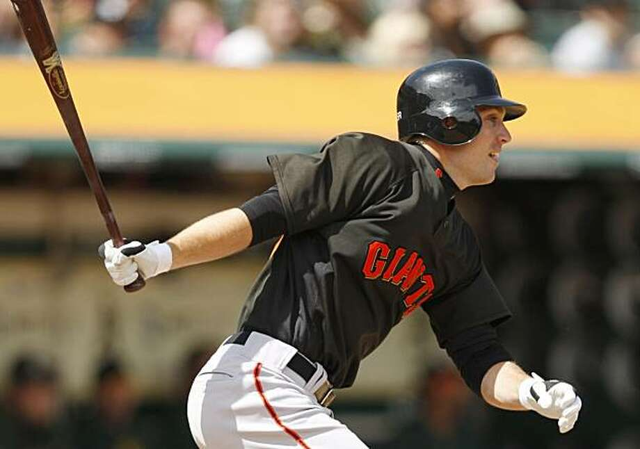 San Francisco Giants' John Bowker swings for a two run home run off Oakland Athletics' Gio Gonzalez during the third inning of an exhibition baseball game Saturday, April 3, 2010, in Oakland, Calif. Photo: Ben Margot, AP