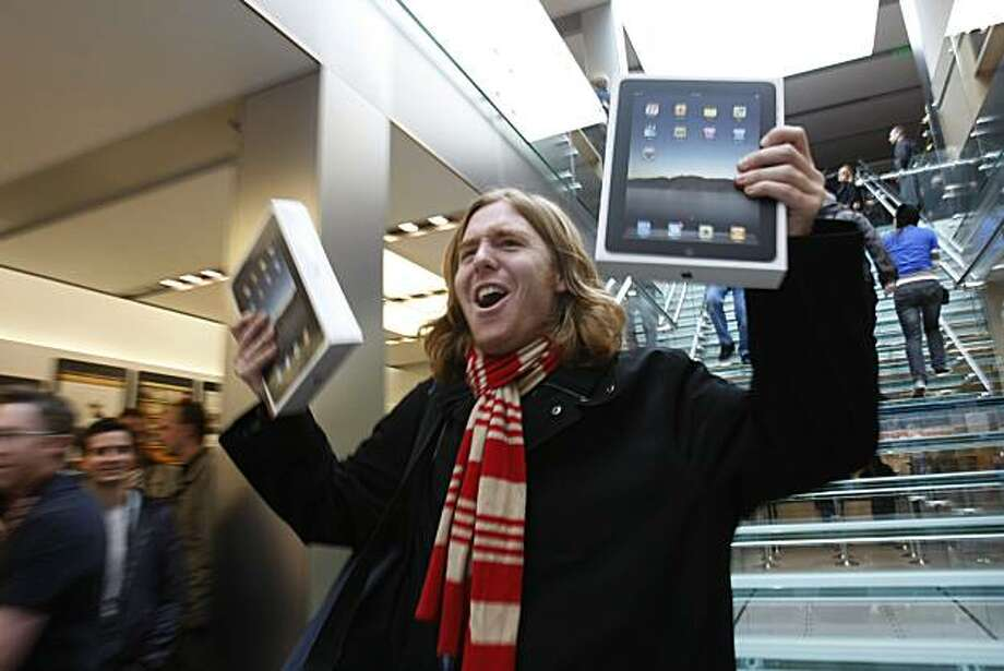 In this file photo taken April 3, 2010, Andres Schobel holds up two iPads as one of the first customers to buy iPads on the first day of Apple iPad sales at an Apple Store in San Francisco. Apple said Monday, April 5, it sold more than 300,000 iPads on Saturday, the day it debuted across the country. Photo: Paul Sakuma, AP