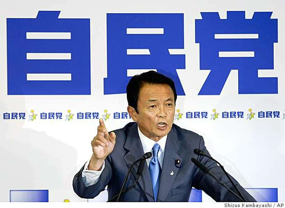Newly elected Liberal Democratic Party President Taro Aso  speaks during a press conference at the party headquarters  in Tokyo, Japan, Monday, Sept. 22, 2008.  Brash conservative Taro Aso easily won the presidency of Japan's struggling ruling party Monday, virtually ensuring his election as prime minister later this week amid political and economic turmoil.  The party name is seen on board, rear. (AP Photo/Shizuo Kambayashi) Photo: Shizuo Kambayashi, AP