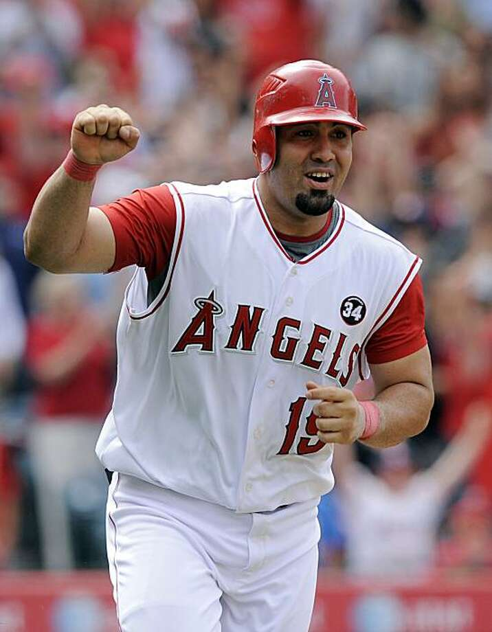 Los Angeles Angels' Kendry Morales celebrates his game-winning RBI-single during the ninth inning of a baseball game against the Seattle Mariners, Sunday, May 31, 2009, in Anaheim, Calif. The Angels won 9-8. (AP Photo/Mark J. Terrill) Photo: Mark J. Terrill, AP