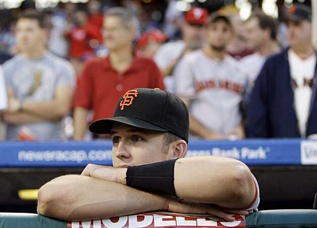 San Francisco Giants catcher Buster Posey watches the pregame ceremony from the dugout before a baseball game against the Philadelphia Phillies, Wednesday, Sept. 2, 2009, in Philadelphia. (AP Photo/Matt Slocum) Photo: Matt Slocum, AP