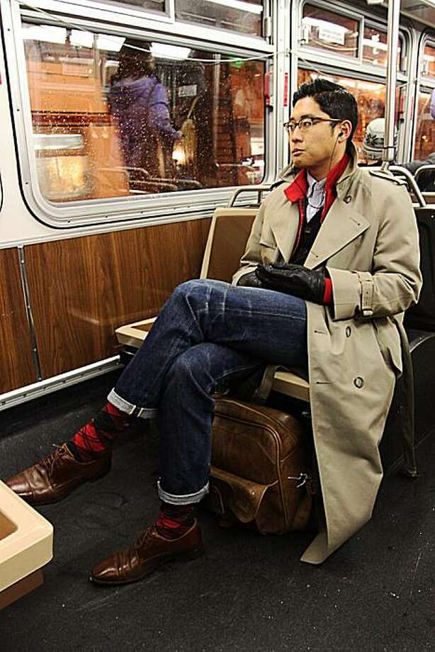 """Gautam Sodera is one of a group of people blogging about street style in San Francisco. His blog is called The Avant-Gardist. """"Will, an inspiring lawyer at USF, on his way to meet a friend on the 5 bus line. His style is seamless with the highlights of red to contrast the beautiful beige overcoat."""" Photo: Gautam Sodera, The Avant-Gardist"""