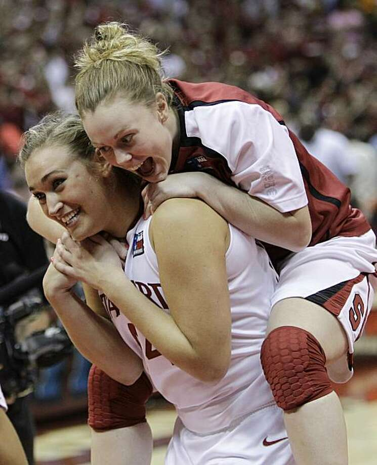 Stanford's Lindy La Rocque jumps onto Joslyn Tinkle as they celebrate following after Stanford defeated Oklahoma 73-66 in a semifinal in the Final Four of the NCAA women's college basketball tournament Sunday, April 4, 2010, in San Antonio. Photo: Eric Gay, AP