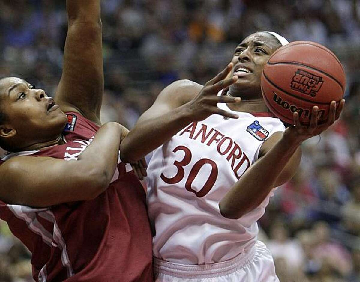 Stanford's Nnemkadi Ogwumike takes a shot against Oklahoma's Abi Olajuwon in the first half of a semifinal in the Final Four of the NCAA women's college basketball tournament Sunday in San Antonio.