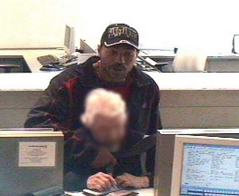 San Francisco police are seeking the public?s help in locating a bank robbery suspect who has robbed four downtown San Francisco banks since March 22. In three of the incidents, the suspect approached a bank customer already at the teller window and placed a knife to the customer?s throat. On April 5, 2010 the suspect entered City National Bank, 150 California Street, stood behind a 90-year-old Hispanic female customer at the teller window, and held a knife to her throat. After demanding and receiving currency, the suspect fled the bank. The victim was not injured. Photo: San Francisco Police Dept.