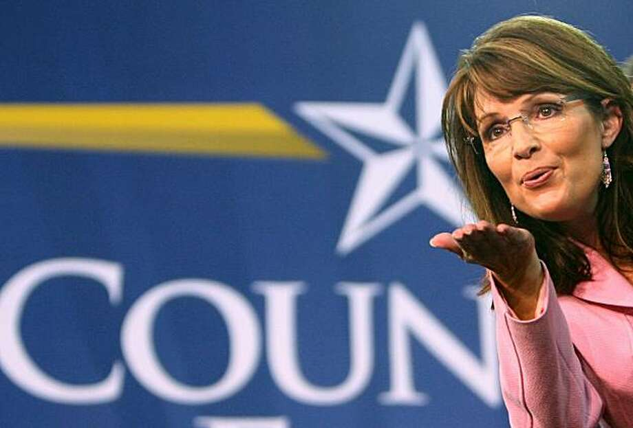 "FILE - In this Oct. 26, 2008 file photo, Republican vice presidential candidate Alaska Gov. Sarah Palin blows a kiss to supporters after speaking at a rally at the Silver Spurs Arena, in Kissimmee, Fla. A day after abruptly announcing she would soon give up her job as governor, Palin on Saturday July 4, 2009 indicated on a social networking site that she would take on a larger, national role, citing a ""higher calling"" to unite the country along conservative lines. (AP Photo/Joe Burbank, Pool, File) Photo: Joe Burbank, AP"