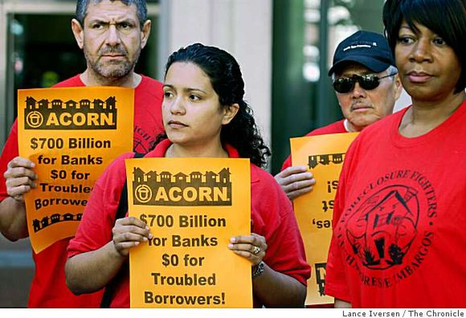 Friends of struggling homeowners and members of ACORN, Jorge Menjivar (left) from San Mateo, Laura Goldinez from Pacifica, Roberto Peratta from South San Francisco, and Glendora Smith from San Francisco demonstrate in front of The San Francisco Reserve Bank on Market Street Tuesday Sept 23, 2008. Acorn, The association of Community Organizations for Reform Now, passed out flyers asking that Federal Reserve Bank Chairman Ben Bernanke include lifelines to American homeowners facing foreclosures in the big bank bailout bill being presented to Congress today. Photo: Lance Iversen, The Chronicle