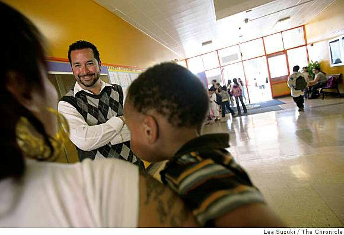 Principal Fernando Yanez (facing camera) talks to Michele Megliorino (left) as he watches over kids during dimissal at Cox Academy on Monday, September 22, 2008 in Oakland, Calif. A new survey of the federal No Child Left Behind Act found that California has more schools in Program Improvement than any other state and that the improvement programs aren't actually working that well. One of the schools in Oakland that's currently on No Child Left Behind, Education for Change at Cox Academy.