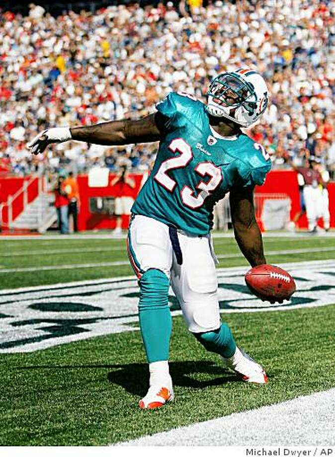 Miami Dolphins' Ronnie Brown prepares to throw the ball up after scoring a touchdown in the second quarter of an NFL football game against the New England Patriots, Sunday, Sept. 21, 2008, in Foxborough, Mass. The Dolphins won 38-13. (AP Photo/Michael Dwyer) Photo: Michael Dwyer, AP