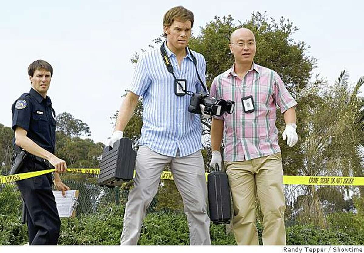 """This undated photo released by Showtime shows actors Michael C. Hall, center, as Dexter, and C.S. Lee, right, as Vince Masuka in a scene from the Showtime dramatic series """"Dexter."""""""
