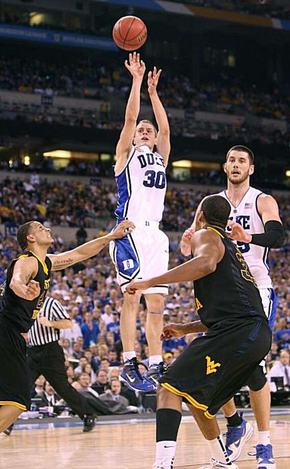 Jon Scheyer of Duke (30) shoots against West Virginia in the first half of an NCAA Final Four semifinal game at Lucas Oil Stadium in Indianapolis, Indiana, Saturday, April 3, 2010. (Chuck Liddy/Raleigh News & Observer/MCT) Photo: Chuck Liddy, MCT