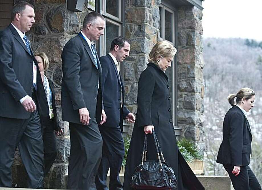 "US Secretary of State Hillary Clinton (2ndR) leaves after  Arctic Ocean meeting in Chelsea on March 29, 2010. Talks on preserving the Arctic amid a race for its rich resources opened amid calls from protestors for the meeting to focus on the damage to thefragile region caused by climate change. US Secretary of State Hillary Clinton told the summit that ""those who have legitimate interests in the region"" should be heard. Photo: Rogerio Barbosa, AFP/Getty Images"