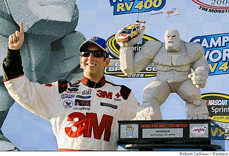 Greg Biffle poses with the trophy after winning the NASCAR Sprint Cup - Camping World RV 400  at Dover International Speedway in  Delaware, September 21, 2008. Photo: Robert LeSieur, Reuters