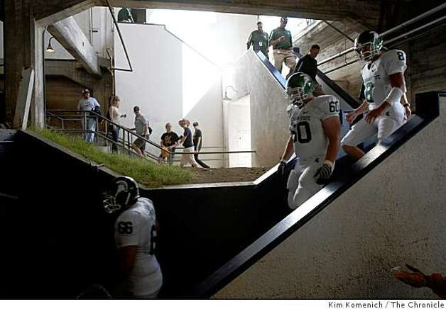 The Michigan State Spartans descend the stairs from the south locker room at Memorial Stadium at U.C. Berkeley in Berkeley Calif., on Saturday, Aug. 30, 2008. Photo: Kim Komenich, The Chronicle