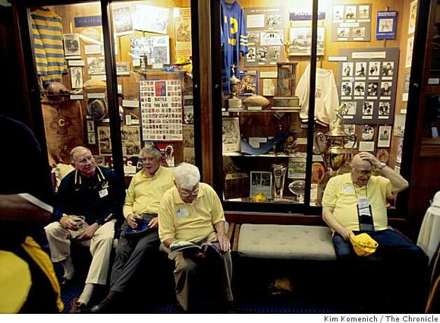 Alumni sit ion benches in front of the displays at the Cal Hall of Fame, under the stands at Memorial Stadium at U.C. Berkeley in Berkeley Calif., on Saturday, Aug. 30, 2008. Photo: Kim Komenich, The Chronicle
