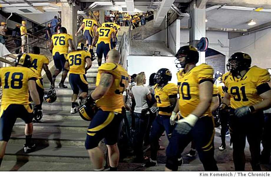 The Cal football team heads up the stairs for a meeting prior to the Michigan State game at Memorial Stadium at U.C. Berkeley in Berkeley Calif., on Saturday, Aug. 30, 2008. Photo: Kim Komenich, The Chronicle