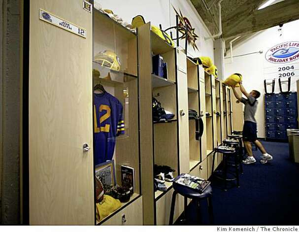 Student equipment manager Kyle Boas puts some pads on a locker in Cal's locker room at Memorial Stadium at U.C. Berkeley in Berkeley Calif., on Saturday, Aug. 30, 2008. The Joe Roth locker is on the left. Photo: Kim Komenich, The Chronicle