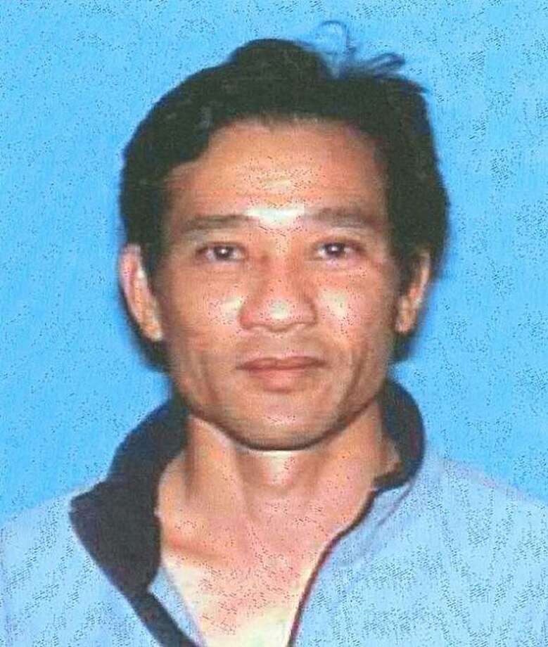 Tong Le, 44, shot to death Sept. 13 in his car at his home in Novato. Photo: DMV Photo, Courtesy To The Chronicle