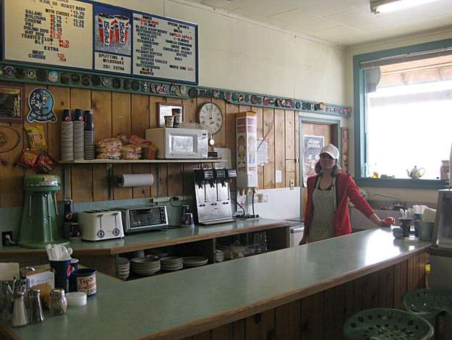 In this March 30, 2010 photo, Jancy Kowalski stands behind the counter of the Judith Gap Mercantile, where she makes milkshakes for Air Force service members who maintain the intercontinental ballistic missiles housed nearby, in Judith Gap, Mont. In America's nuclear heartland, where underground missile silos dot the landscape, a proposed U.S.-Russia treaty to reduce nuclear weapons is nothing short of alarming. The military workers who maintain those missiles support cities as large as Great Falls, where40 percent of the economy depends upon Malmstrom Air Force Base, and businesses as small as the Judith Gap Mercantile, where passing airmen buy milkshakes by the dozen. If they follow the missiles out of town, the economies here could be crippled. Photo: Matt Volz, AP