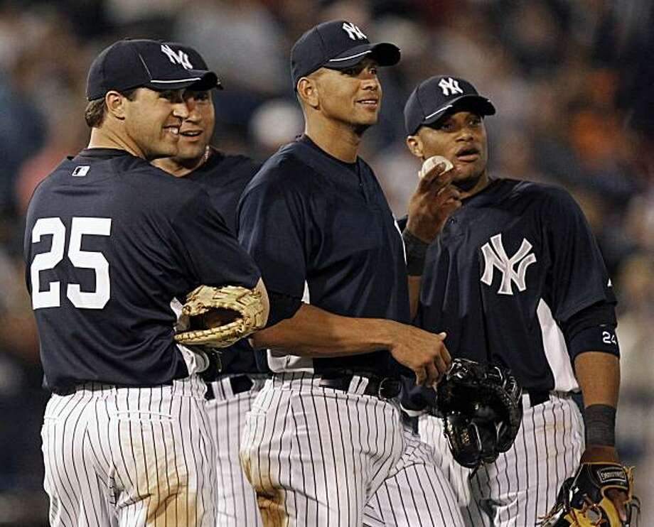 New York Yankees infielders, from left to right, Mark Teixeira, Derek Jeter, Alex Rodriguez and Robinson Cano react during a pitching change in the sixth inning of a spring training baseball game against the Washington Nationals, Wednesday, March 24, 2010, in Tampa, Fla. Photo: Mike Carlson, AP