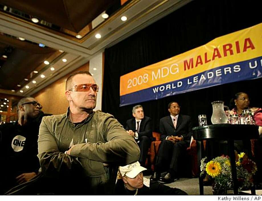 Musicians Youssou N'Dour, of Senegal, left, and Bono listen to speakers at the United Nations 2008 Millennium Development Goals Malaria Summit in New York, Thursday, Sept. 25, 2008.  (AP Photo/Kathy Willens) Photo: Kathy Willens, AP