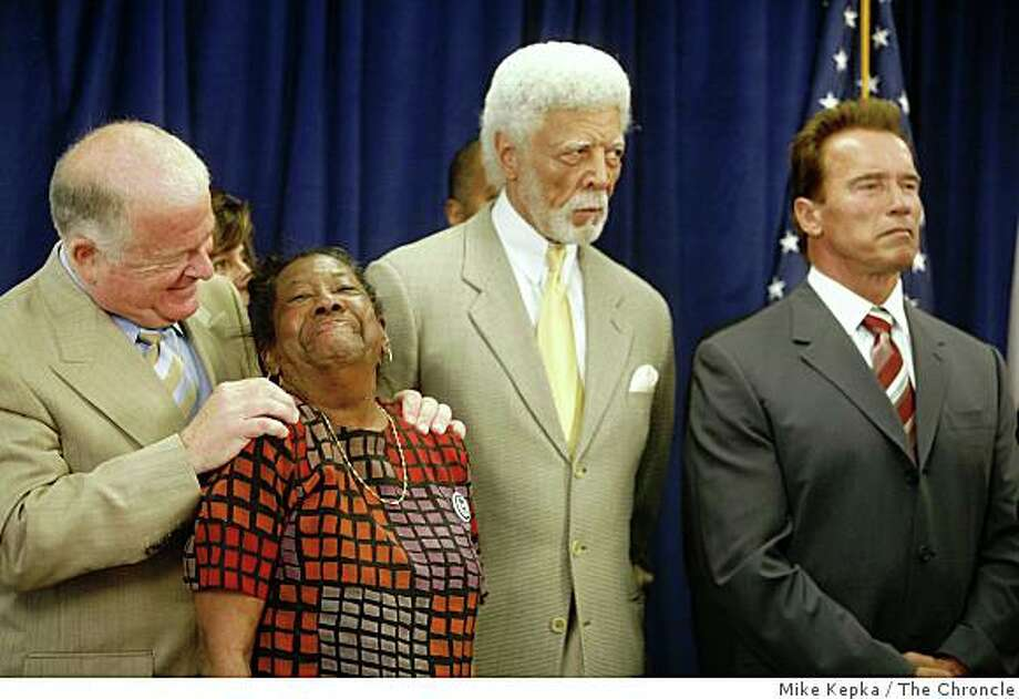 With Oakland's Mayor Ron Dellums and Governor Arnold Schwarzenegger to her right, Dorothy Hicks of Oakland receives a hug from Senate President pro Tem, Don Perata  during a press conference at The Unity Council building on Tuesday July 8, 2008 in Oakland, Calif. where the governor later signed a foreclosure bill called SB1137. Hicks who's home was in foreclosure over a year ago pleaded her case in front of the state senate in Sacramento which kick started Perata's foreclosure bill.Photo by Mike Kepka / The Chronicle Photo: Mike Kepka, The Chroncle