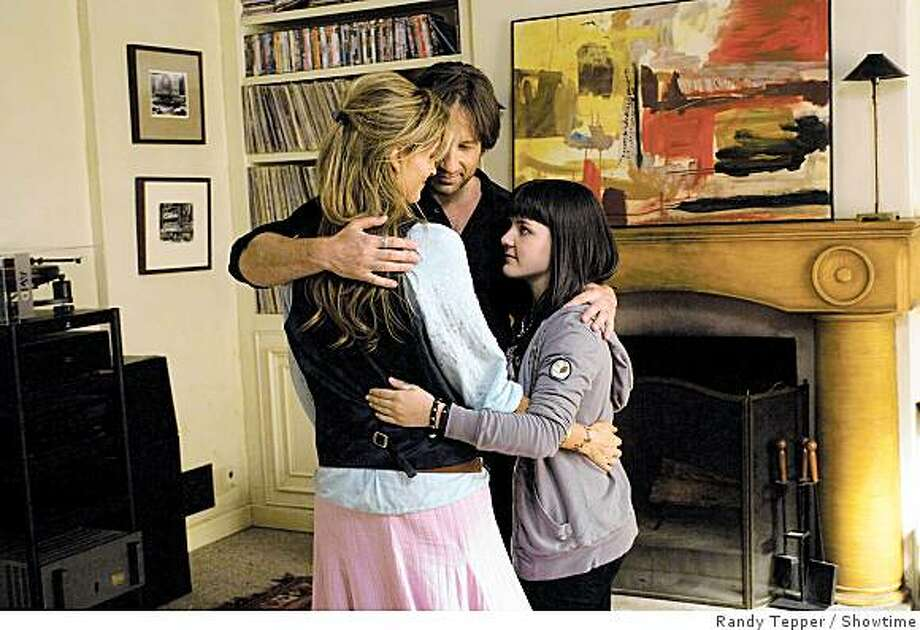 "In this image released by Showtime, from left, Natascha McElhone, David Duchovny and Madeleine Martin are shown in a scene from the Showtime series, ""Californication."" Photo: Randy Tepper, Showtime"