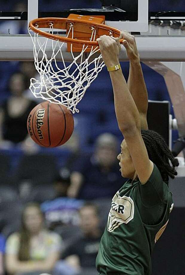 Baylor's Brittney Griner dunks during practice for the NCAA Women's Final Four college basketball tournament Saturday, April 3, 2010, in San Antonio, Texas. Baylor plays Connecticut in a national semifinal game Sunday. Photo: Eric Gay, AP
