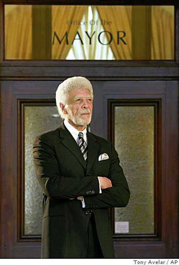 **FILE** In this Tuesday, March 18, 2008, file photo, Oakland Mayor Ron Dellums poses outside his office at City Hall in Oakland, Calif. Dellums is being awarded a prestigious South African government honor on Tuesday, April 22, 2008 for leading the struggle in Congress for the economic sanctions that helped end South African apartheid.  (AP Photo/Tony Avelar) Photo: Tony Avelar, AP