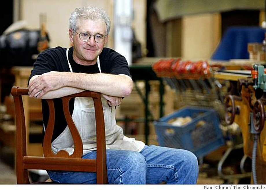 Woodworker John Grew Sheridan sits in a chair he designed at his studio in San Francisco, Calif., on Wednesday, Sept. 24, 2008. Photo: Paul Chinn, The Chronicle