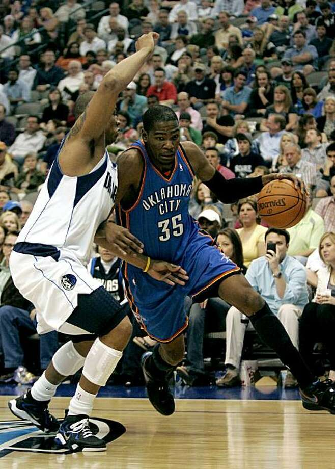 Oklahoma City Thunder forward Kevin Durant (35) drives the ball on Dallas Mavericks forward Caron Butler, left, during the second half of an NBA basketball game against the Dallas Mavericks in Dallas on Saturday, April 3, 2010. The Thunder won 121-116. Photo: Mike Fuentes, AP