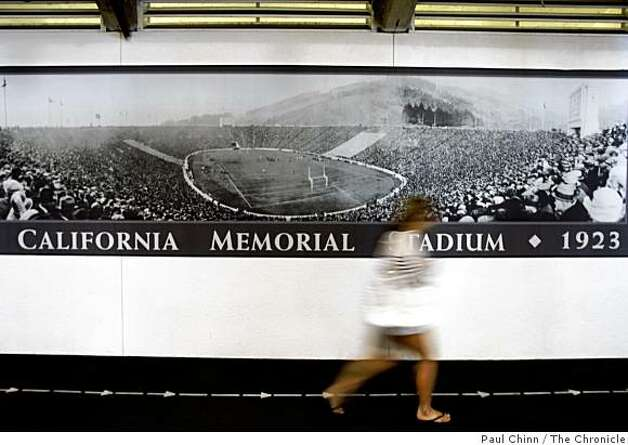 A student walks past a large panorama of the first football game played at Cal's Memorial Stadium in Berkeley, Calif., on Wednesday, Sept. 24, 2008. Photo: Paul Chinn, The Chronicle