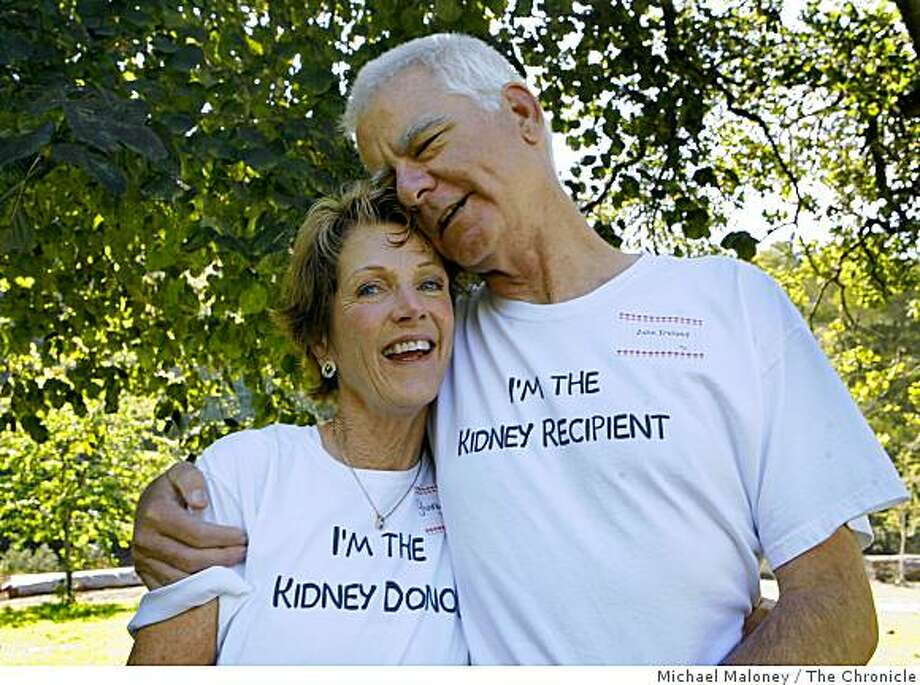 Tennis partners Ginny Mayer of Newark, Calif., and John Ireland of Fremont, Calif., wear t-shirts celebrating their May 2, 2008 surgery at UCSF. The staff at UCSF held a celebration in Golden Gate Park in San Francisco, Calif., on Sept. 24, 2008, celebrating 45 years of kidney and liver transplants. They invited their staff along with many donors and recipients to the pasta picnic in the park. Photo: Michael Maloney, The Chronicle