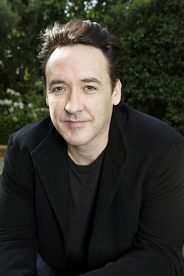 In this March 20, 2010 photo, actor John Cusack poses for a portrait in Los Angeles. Photo: Reed Saxon, AP