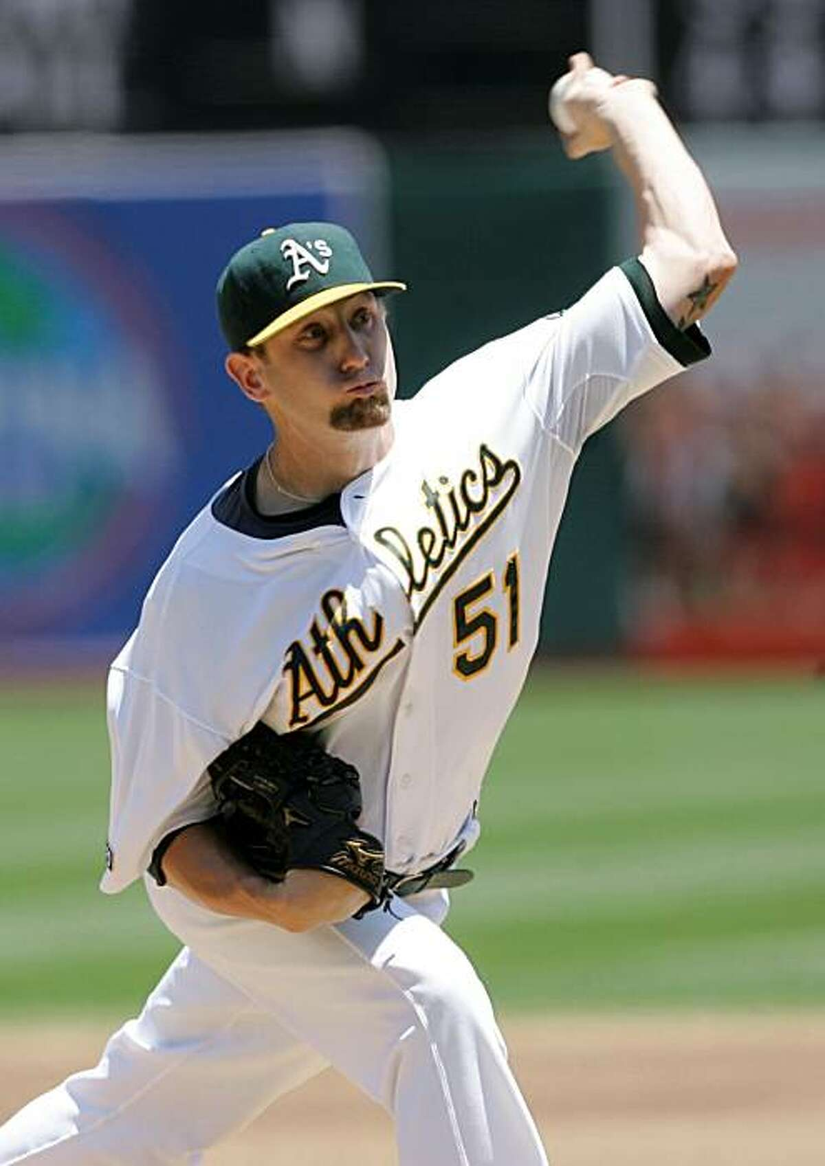 Oakland Athletics' Dallas Braden pitches against the Detroit Tigers in the third inning of a baseball game Wednesday, July 1, 2009, in Oakland, Calif. (AP Photo/Jeff Chiu)